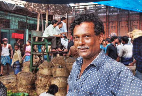 Man Works At The Auction Market (India)