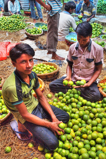 Man Beside A Heap Of Orange @ India