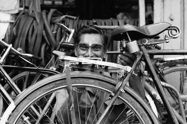 Man repairing bicycles