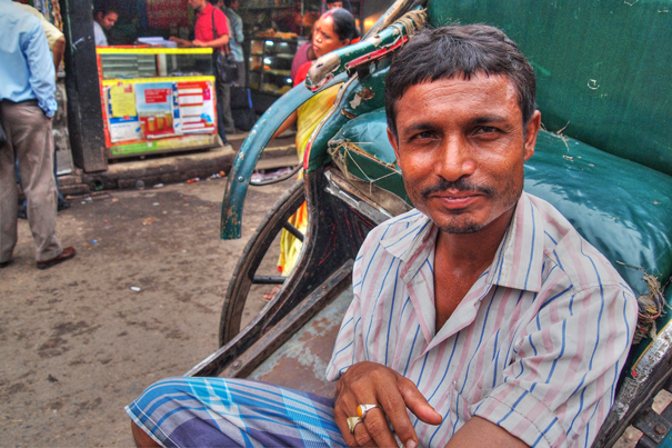 Rickshaw Wallah Wearing A Striped Shirt (India)