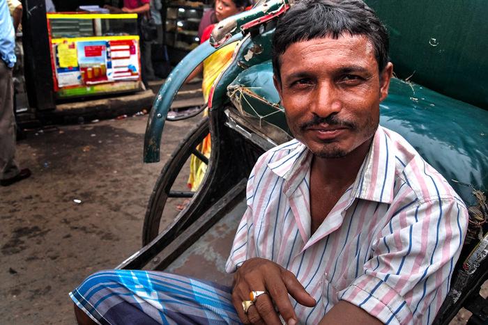 Rickshaw Wallah Wearing A Striped Shirt (India)