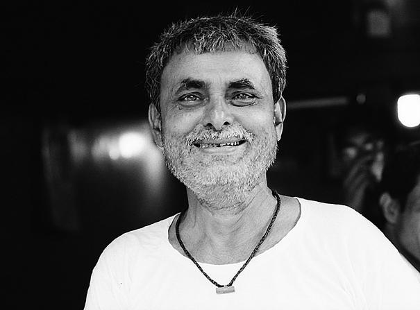 Man With Gray Stubble Smiles (India)
