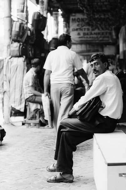 Man Hiding From The Rain (India)