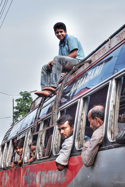 Young Man On The Roof Of A Bus (India)