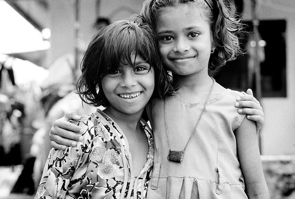 Two Smiling Girls Standing Close (India)