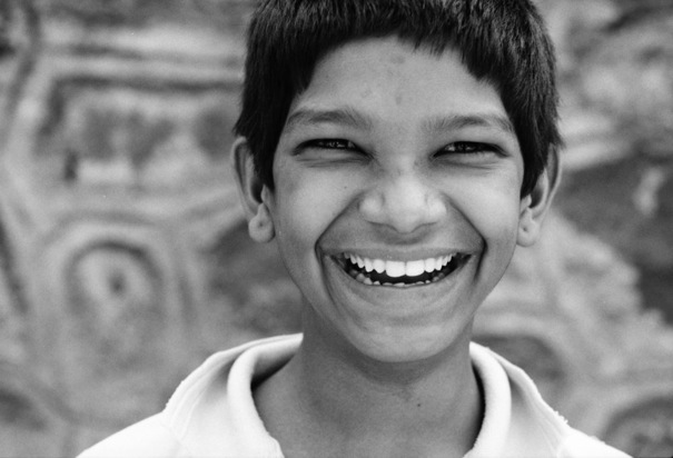 Boy Had Narrowed Eyes And Laughed @ India