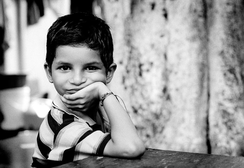 Boy resting chin on his hand