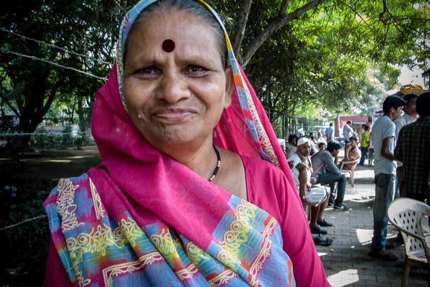 Older woman with deep red Bindi