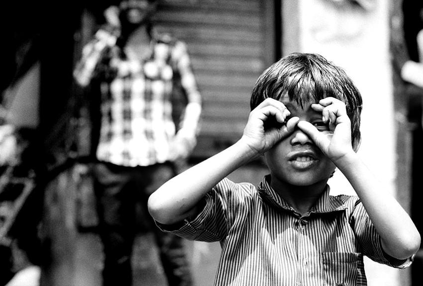 Boy pretending to peek