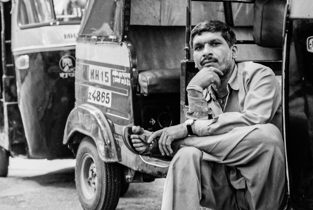 Driver sitting cross-legged