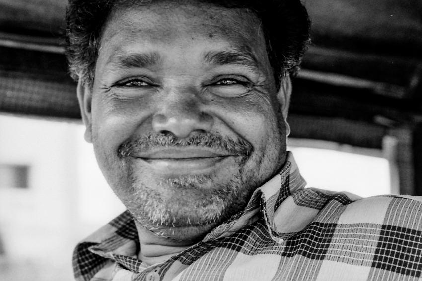 Man smiling on auto rickshaw
