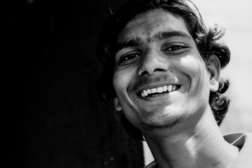 Young man showing teeth
