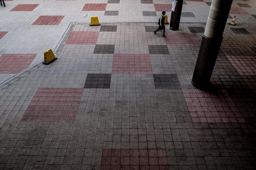 Woman walking square