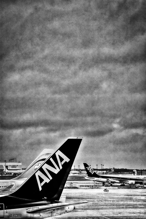 Airplanes being parked at Narita Airport