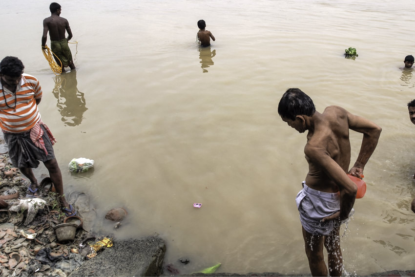 People soaking in river
