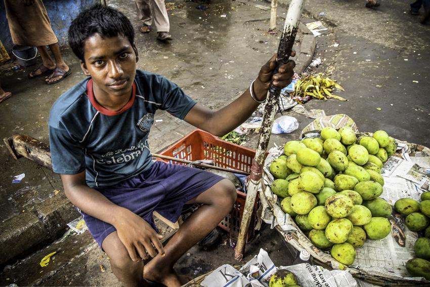 Boy selling mango