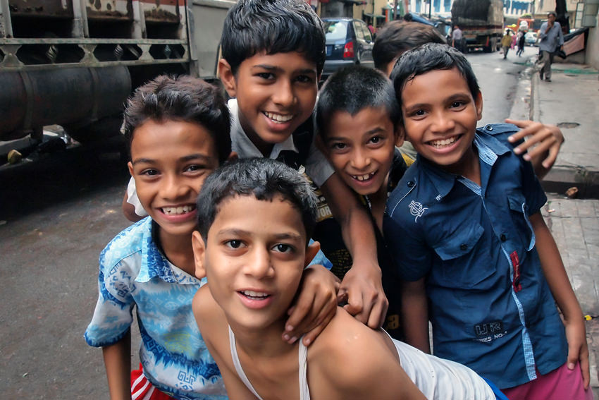 Boys laughing in street