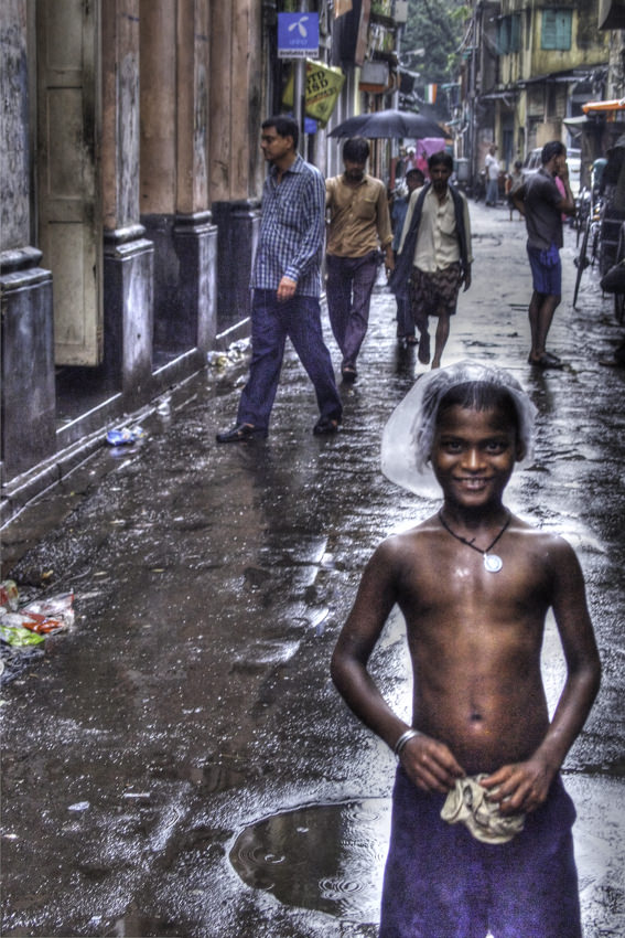 Boy standing in rain