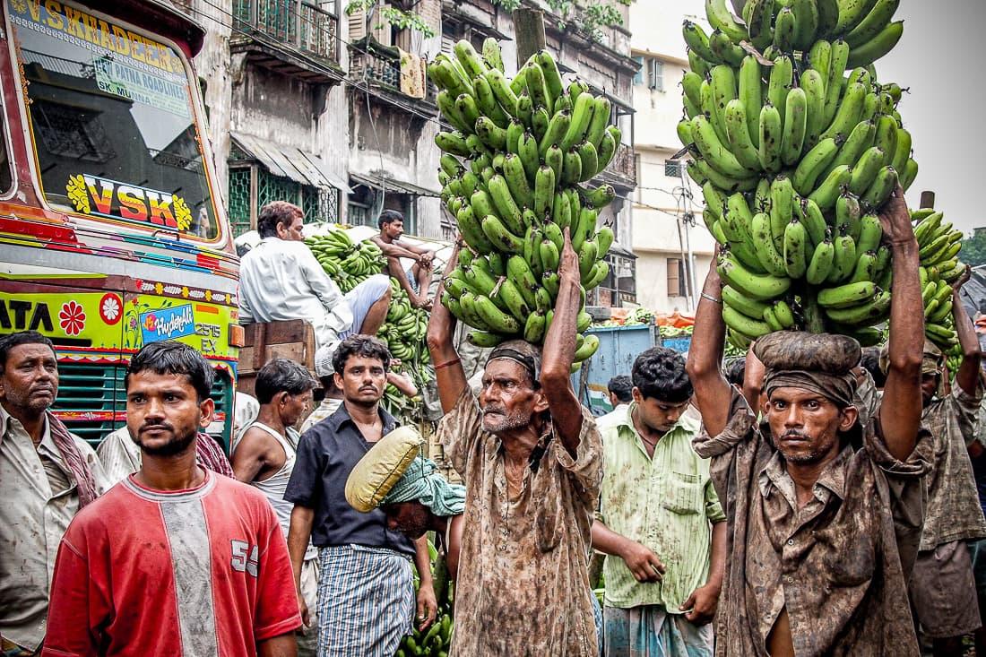 Men carrying bananas