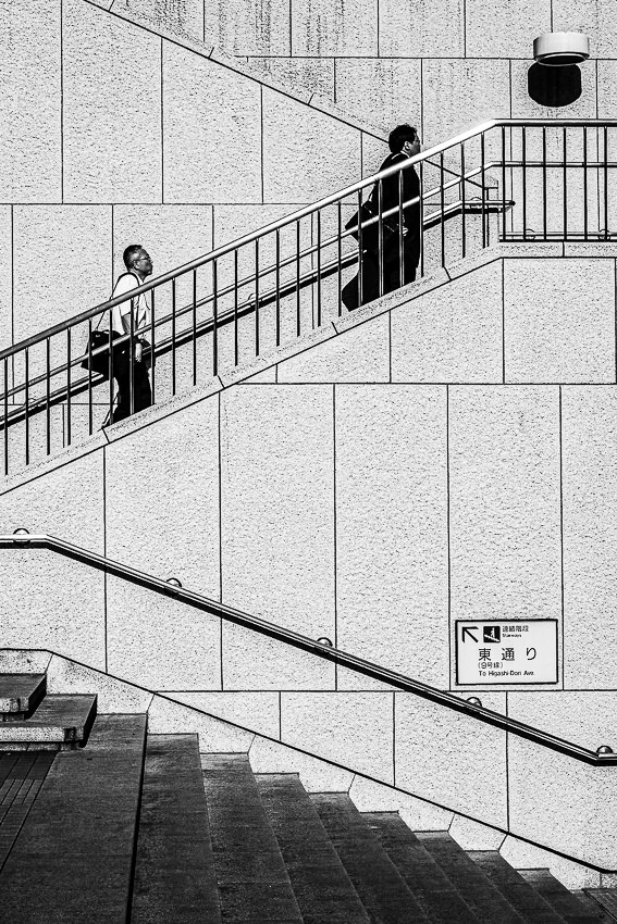 Figures climbing stairs