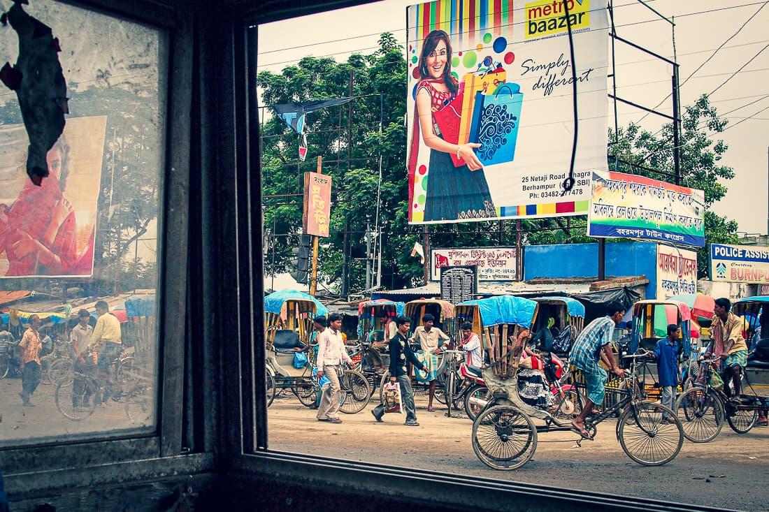 Cycle rickshaws running crossing