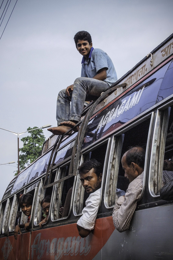 Young man on roof of bus