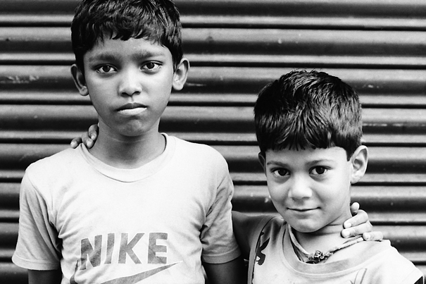 Two Boys Standig By The Shutter @ India