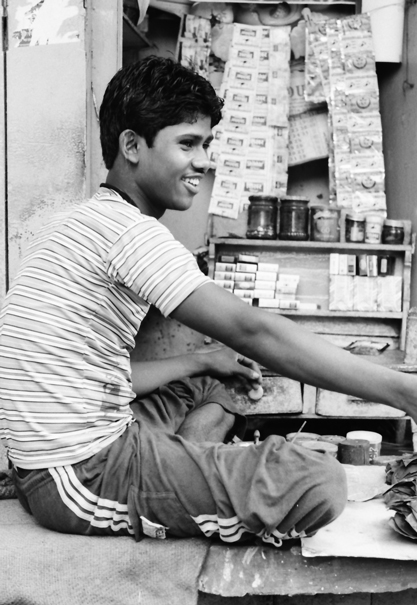 Young Tobacconist In A Corner Of A Street (India)