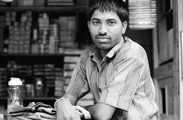 Unshaven Man At A General Store @ India