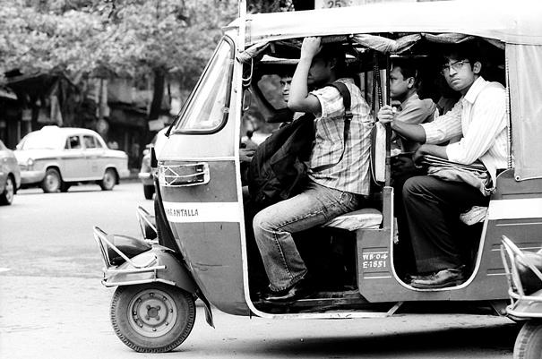 Passengers On An Auto Rickshaw @ India