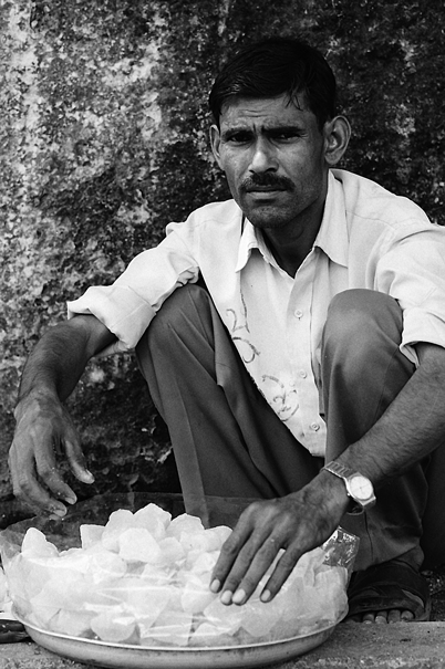 Peddler with confused look
