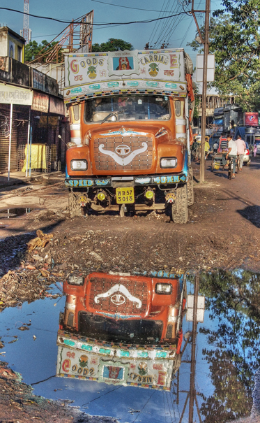 Reflection Of A Truck In A Puddle @ India
