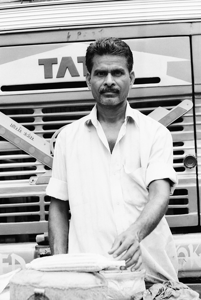 Man Toasiting In Front Of A Truck (India)