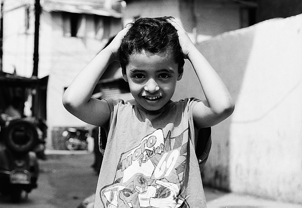 Boy holding head