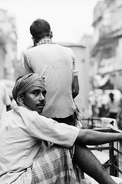 Man Looked Back On The Luggage Carrier (India)