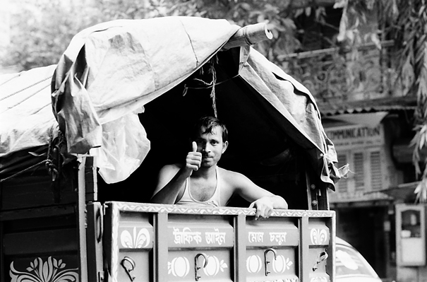 Man On The Rear Of A Truck (India)