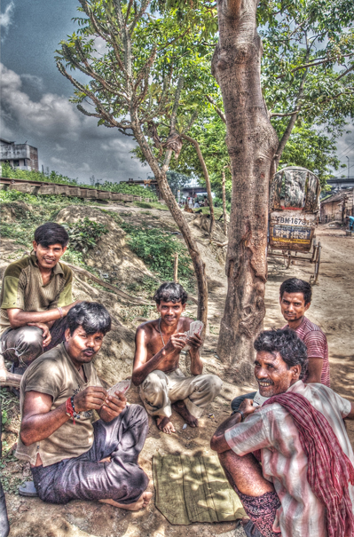 Men Playing Cards At The Side Of Railroad @ India