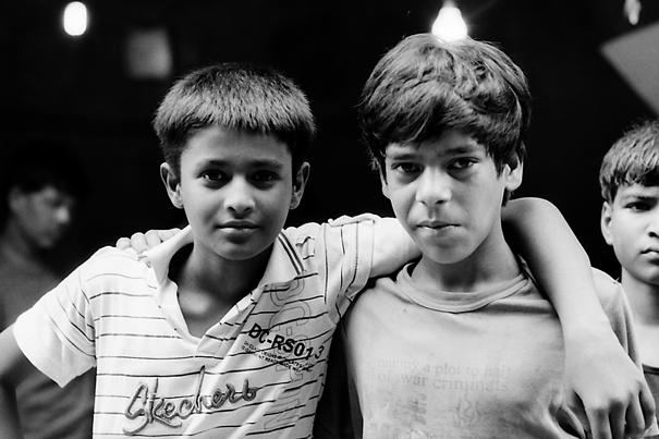 Boys standing shoulder-to-shoulder