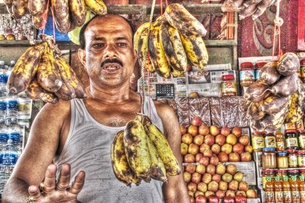 Man And Dangly Bananas (India)