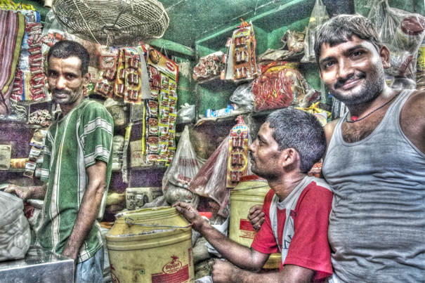 Three Men Piddling Around In A Shop (India)