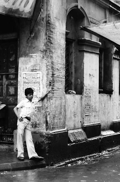 Young man standing in corner of street