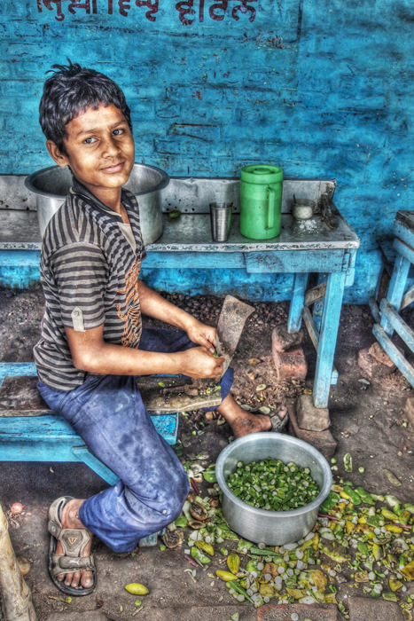 Boy Cutting Vegetables (India)