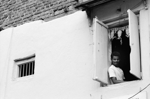 Smiling Man By The Upstairs Window (India)