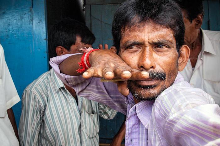 Man Fixing A Pose (India)