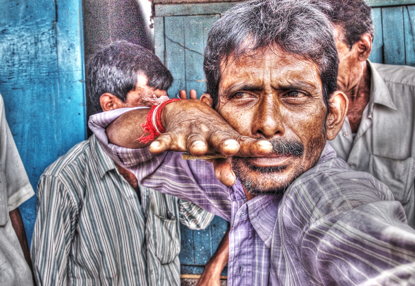 Man Fixing A Pose (India)