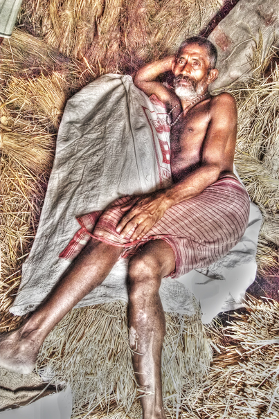 Man Lying Down On The Wheat Straw (India)