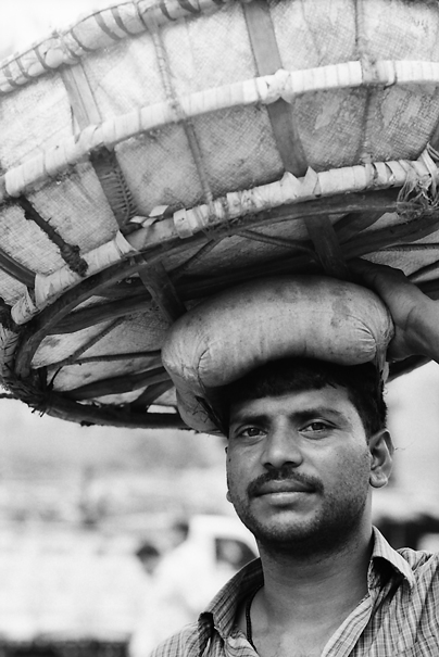 Huge Basket On His Head (India)