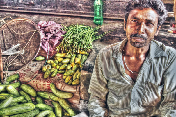 Man Selling Cucumbers @ India