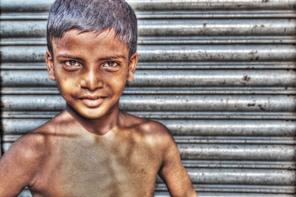 Imposing Boy In Front Of The Shutter (India)