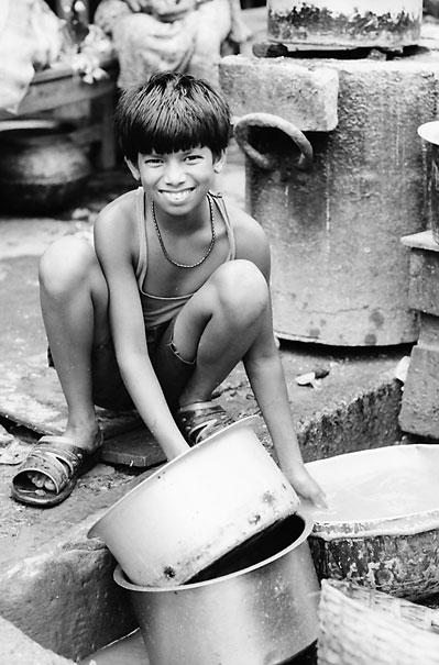 Boy Scrubbing Pans (India)